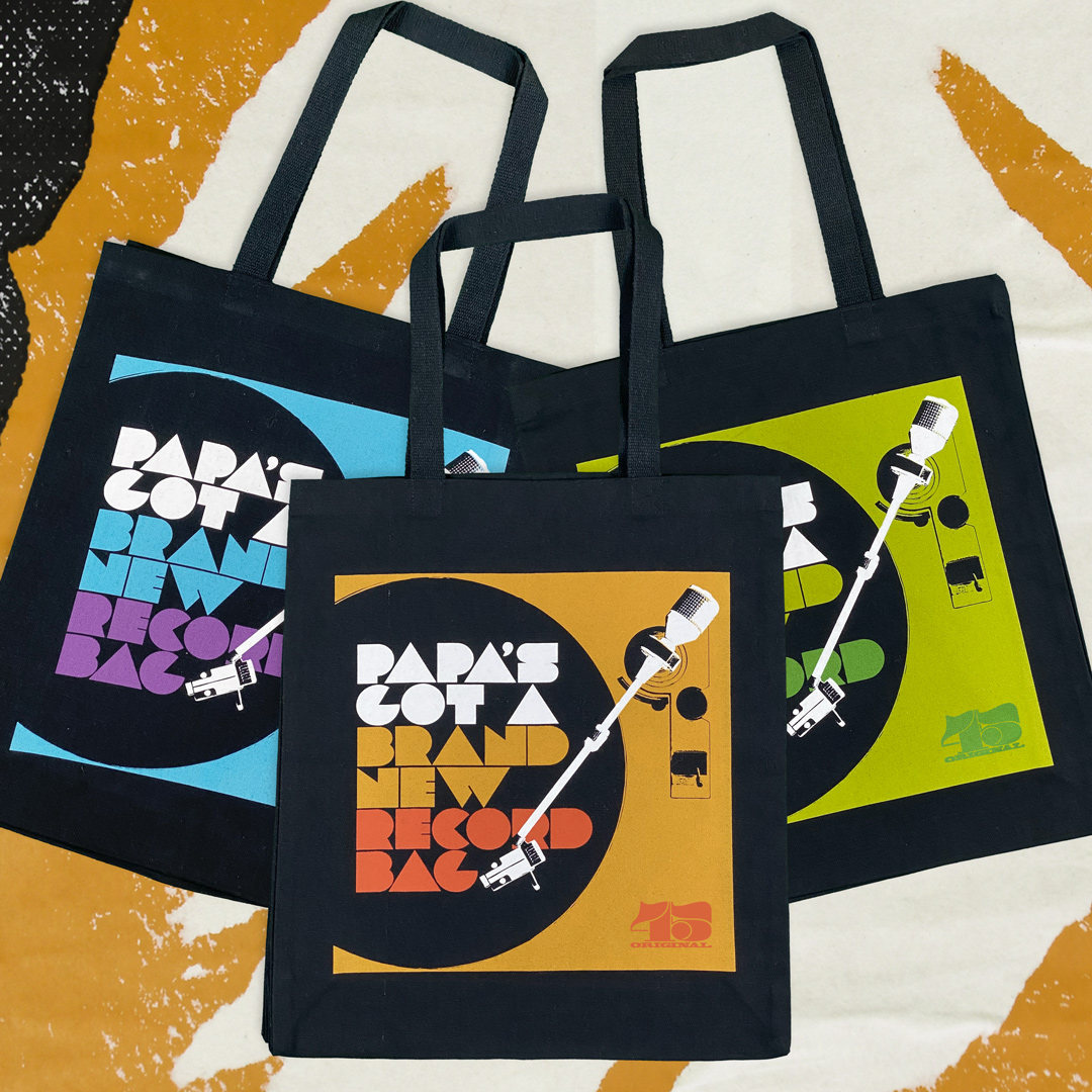Three designer tote bags with 'Papa's got a brand new bag' design