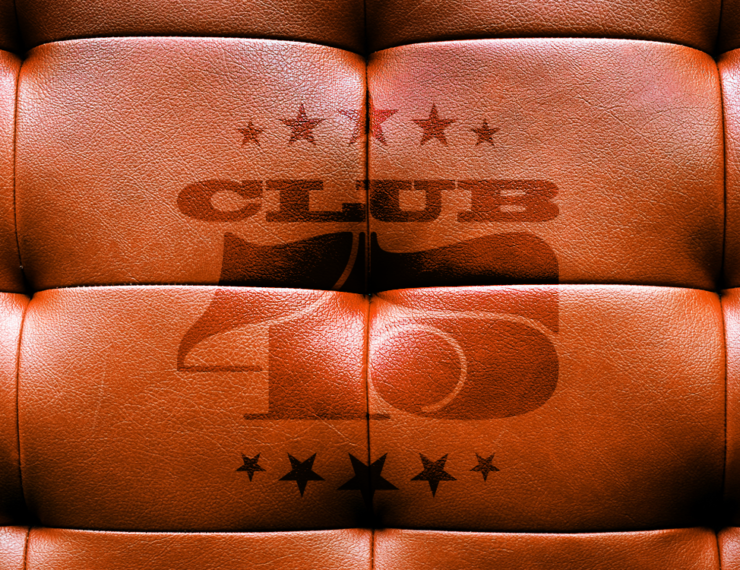 Brown leather sofa embossed with Club45 logo, the club for record collectors, merch and music lovers
